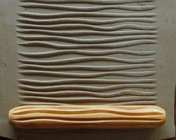 Rodillo de madera para fines artísticos
